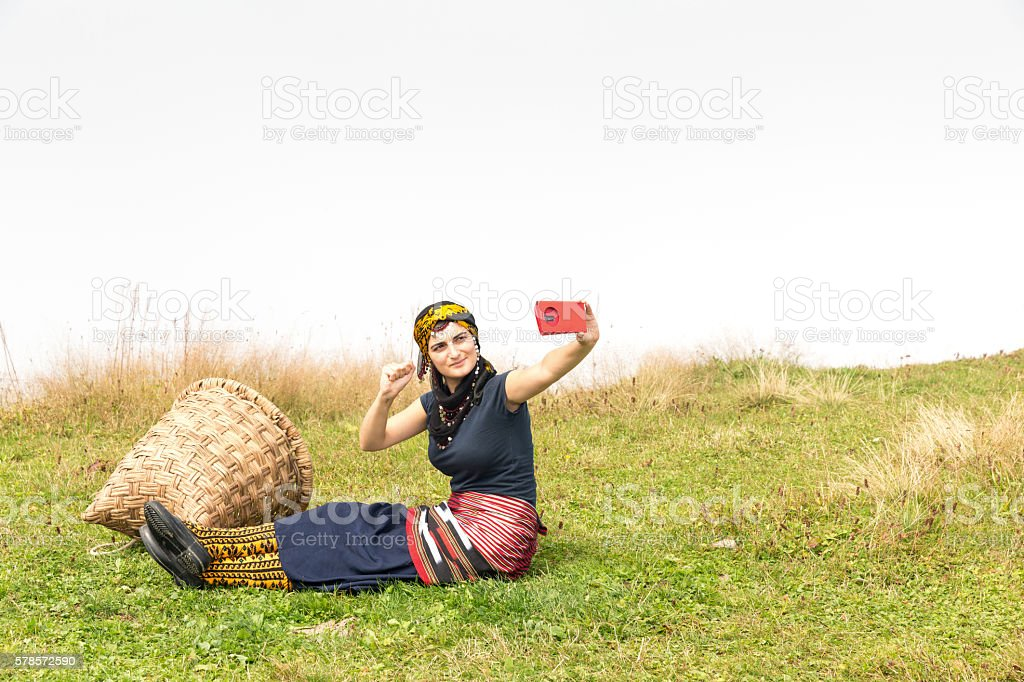 traditional woman enjoying a day outdoors stock photo