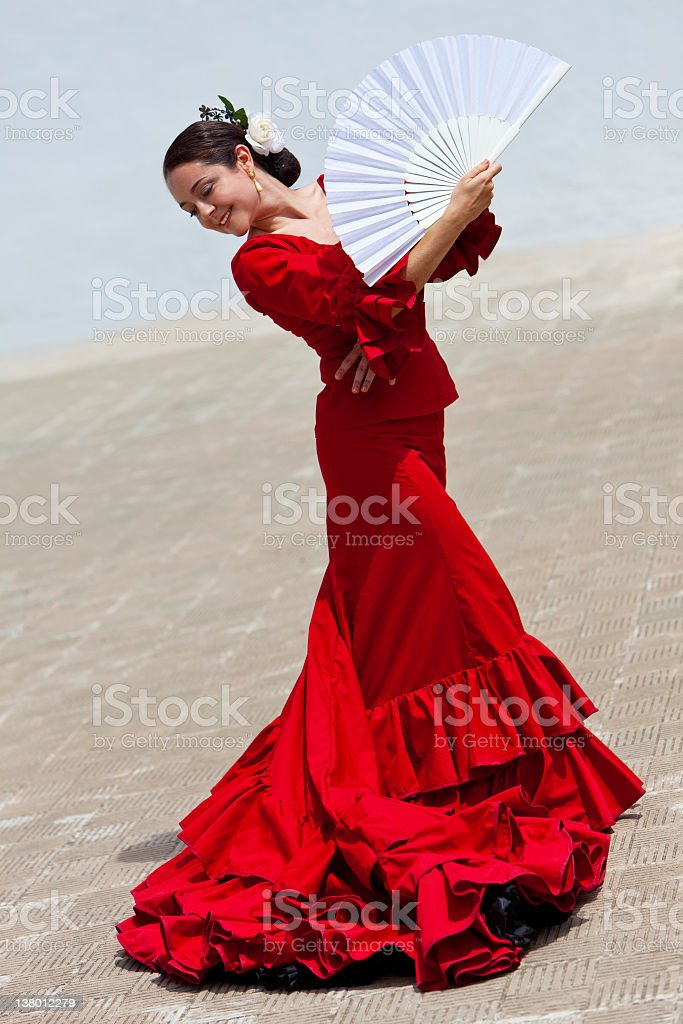 Traditional Woman Spanish Flamenco Dancer In Red Dress With Fan stock photo