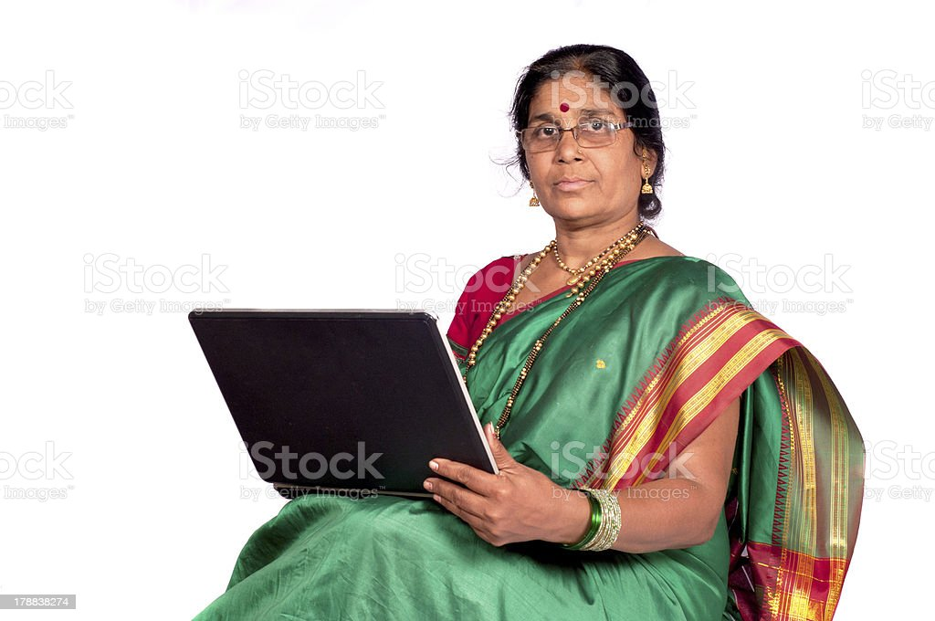 Traditional Woman Working on Computer royalty-free stock photo