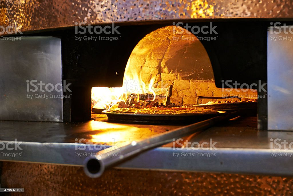 Traditional wood fired pizza stock photo