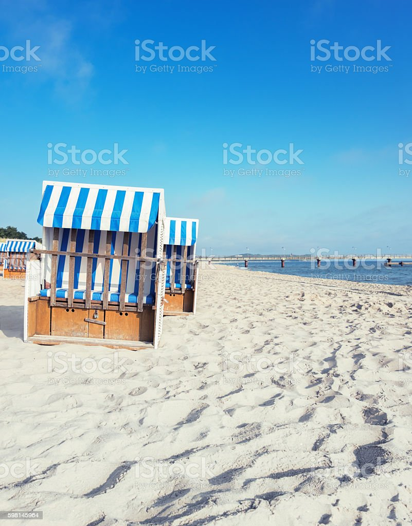 Traditional wooden beach chairs on the coast of Baltic Sea stock photo