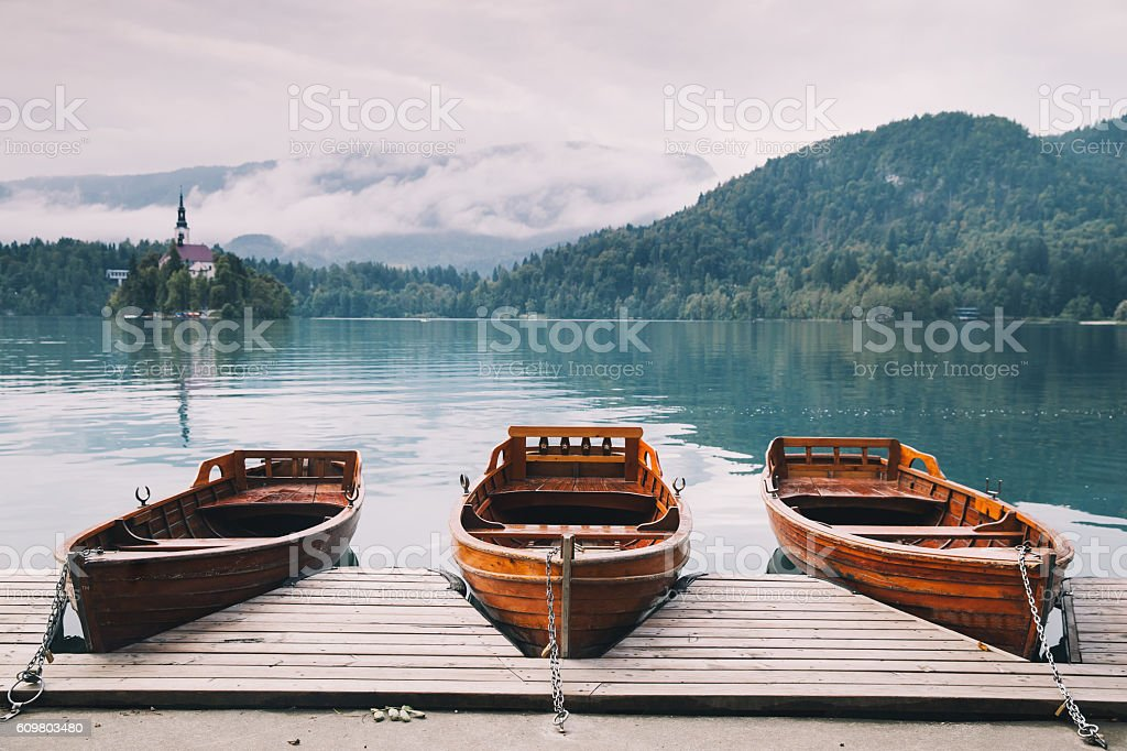 Traditional wooden boats on Lake Bled, Slovenia. stock photo