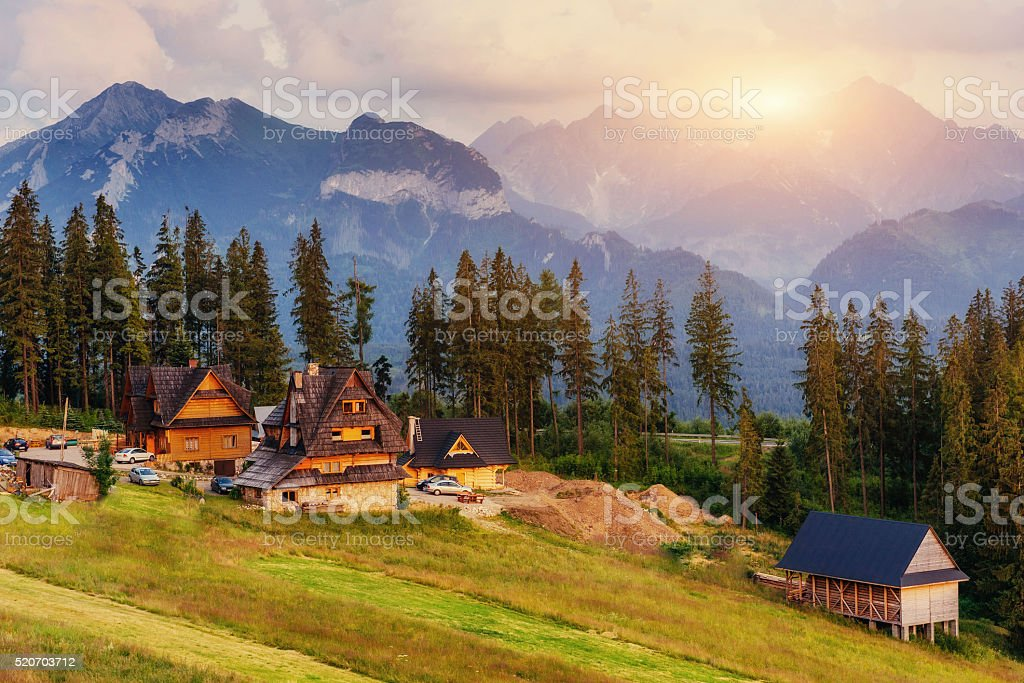 Traditional wooden house in the mountains. stock photo