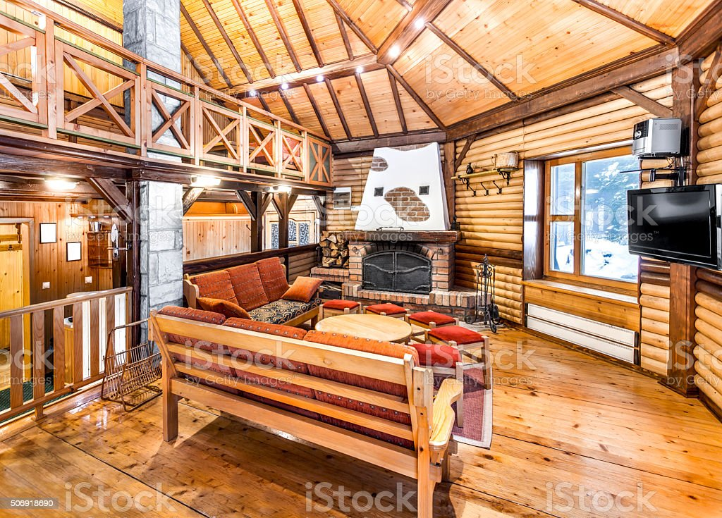 Traditional wooden interior with table and fixtures - mountain hall stock photo