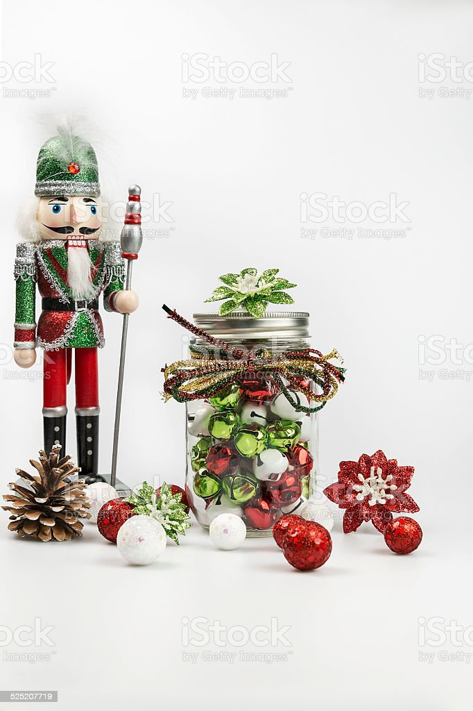 Traditional wooden nutcracker with various Christmas symbols on white background stock photo