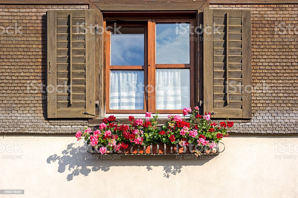 Traditional wooden shingles and window stock photo