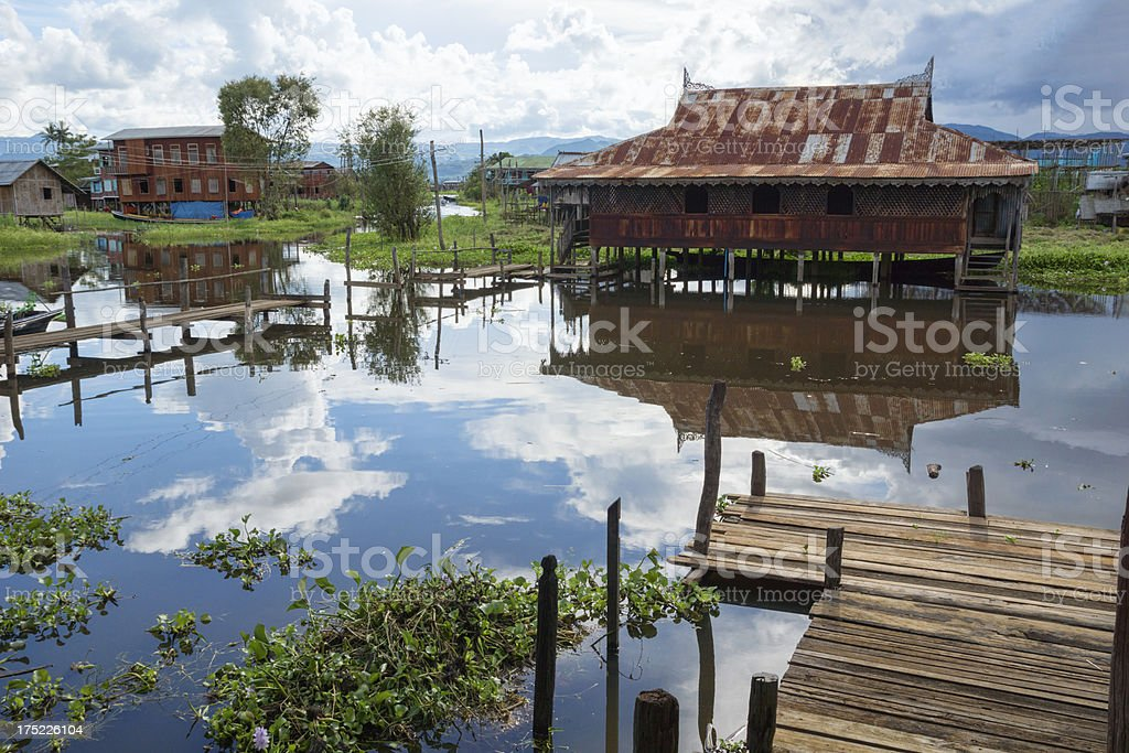 Traditional wooden stilt houses at Inle Lake royalty-free stock photo
