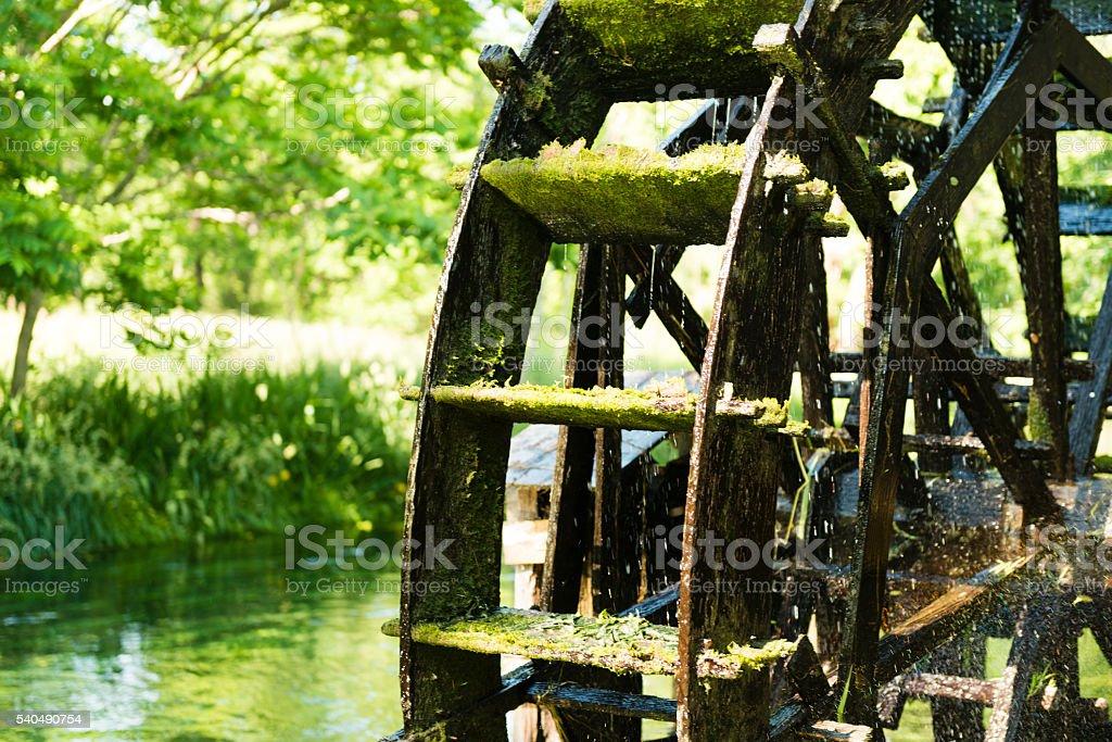 Traditional Wooden Waterwheel Turning in River Nagano Japan stock photo