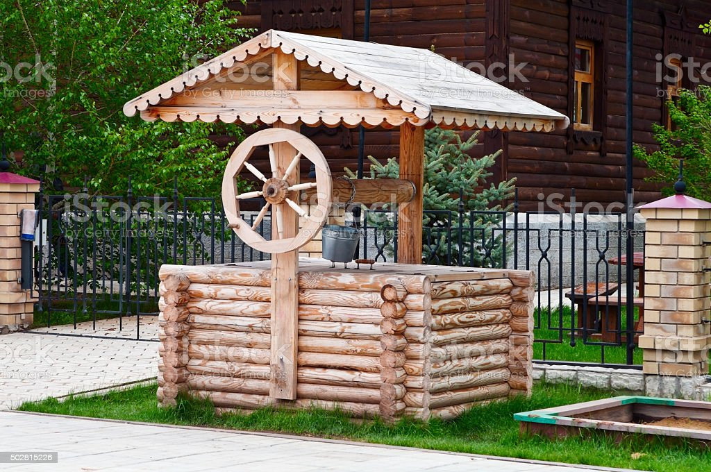 Traditional wooden well stock photo