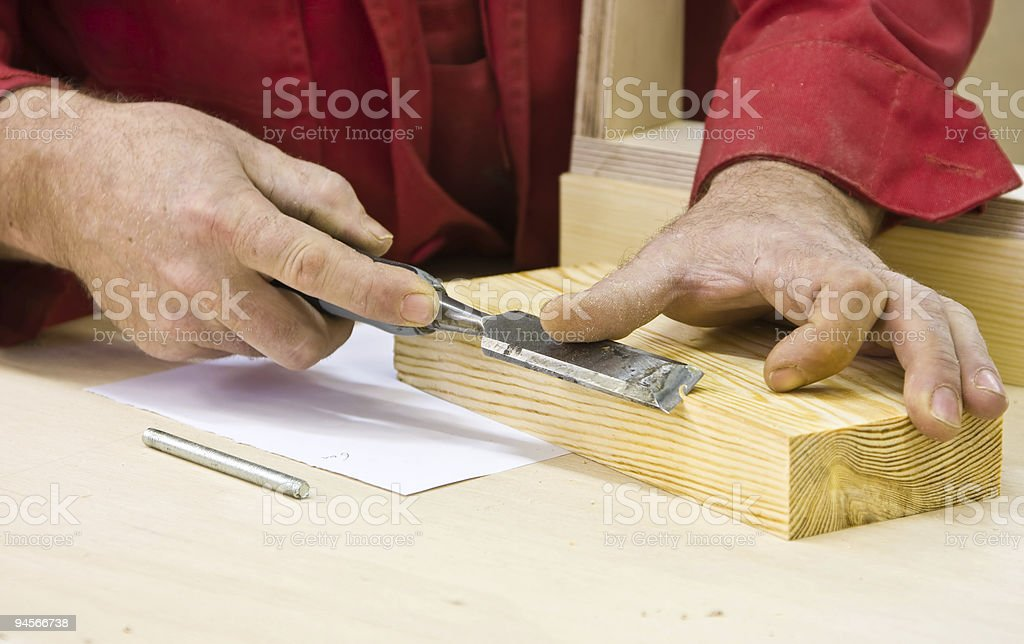 Traditional woodworker using chisel royalty-free stock photo