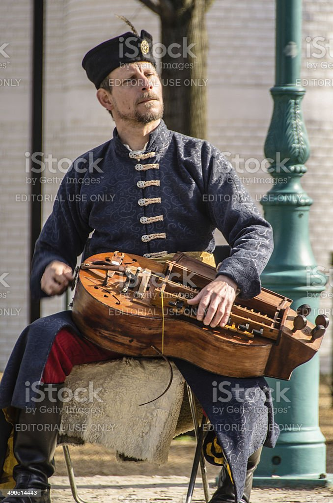 Traditionally Dressed Hungarian Man playing the Wind-Lute stock photo