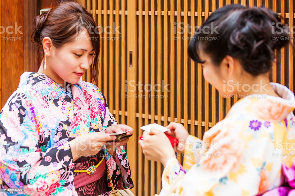 Traditionally Dressed Japanese Women in Kimonos Greet Each Other stock photo