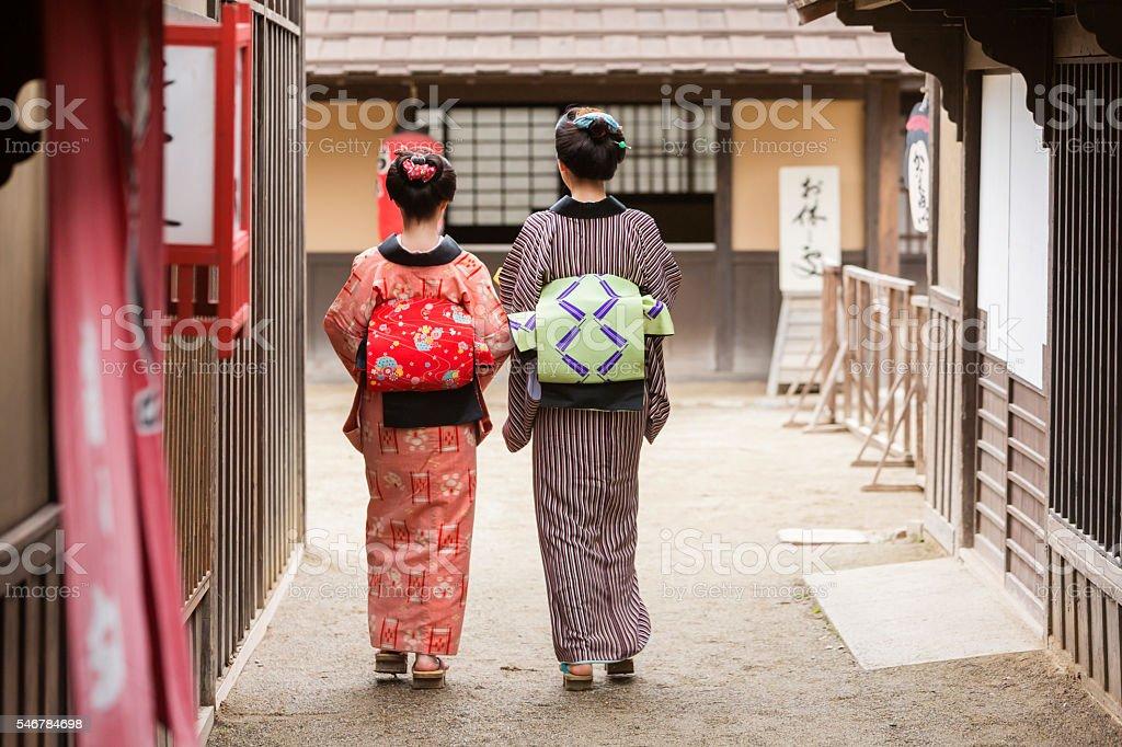 Traditionally Dressed Japanese Women in Kimonos Walking stock photo