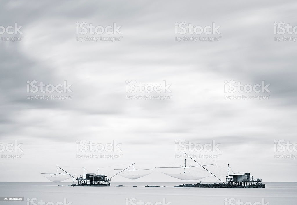 Traditonal fishing houses in th sea with copyspace stock photo
