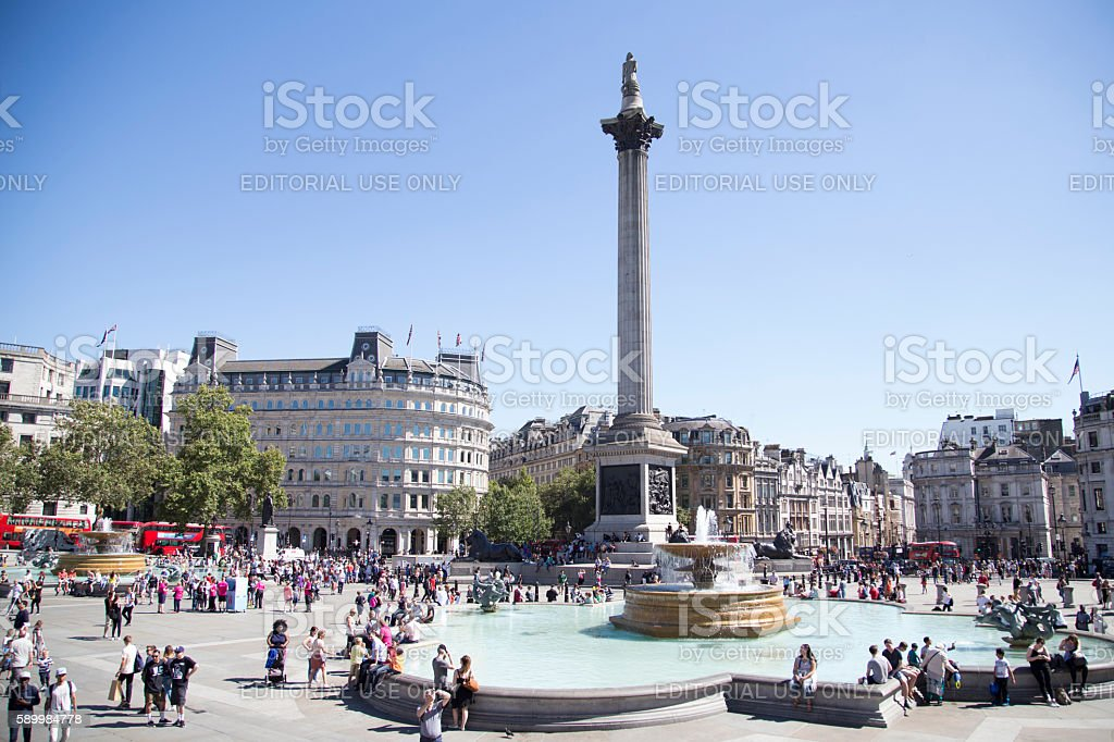 Trafalgar square on a sunny and very busy day stock photo