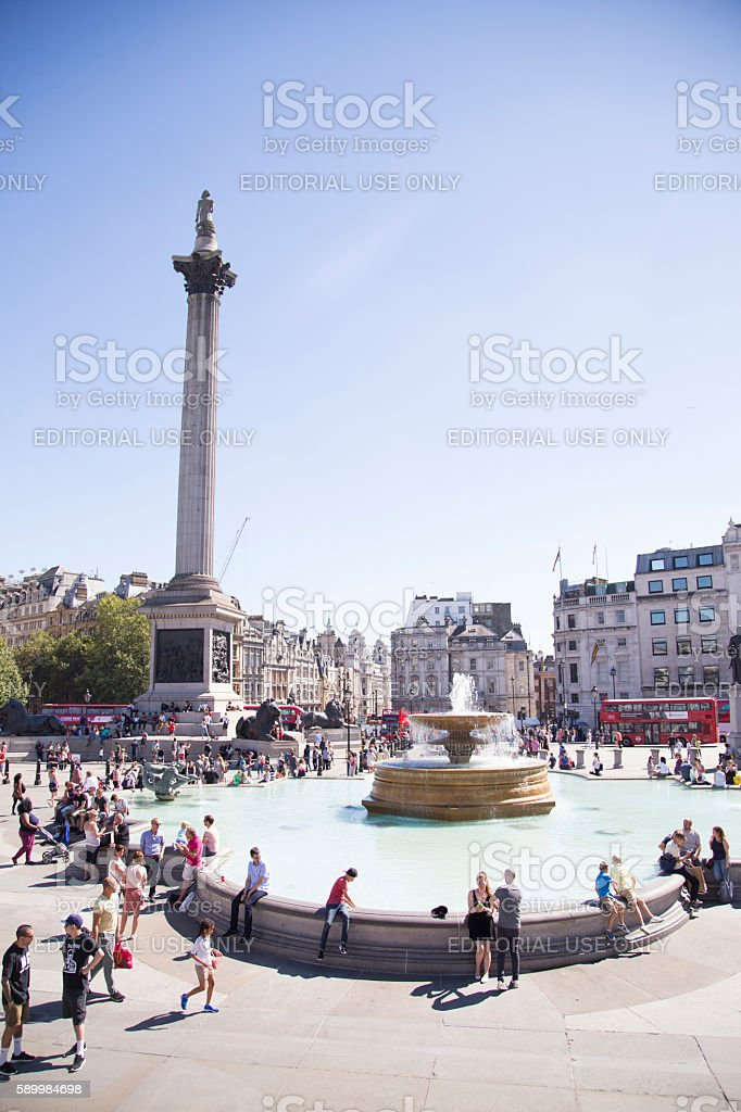 Trafalgar square ona bright sunny day with lots of tourists stock photo