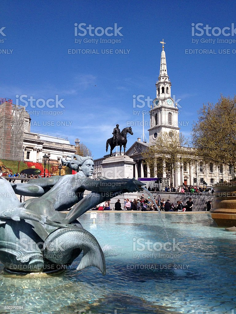 Trafalgar Square with fountain and church in London stock photo