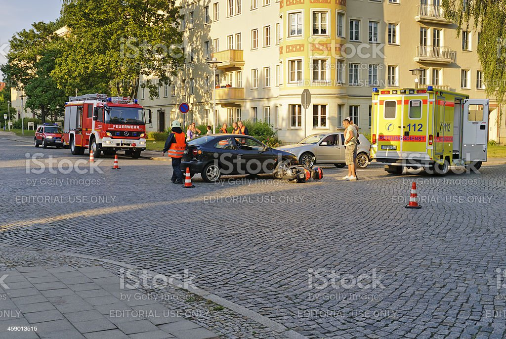 Traffic accident between car and scooter stock photo