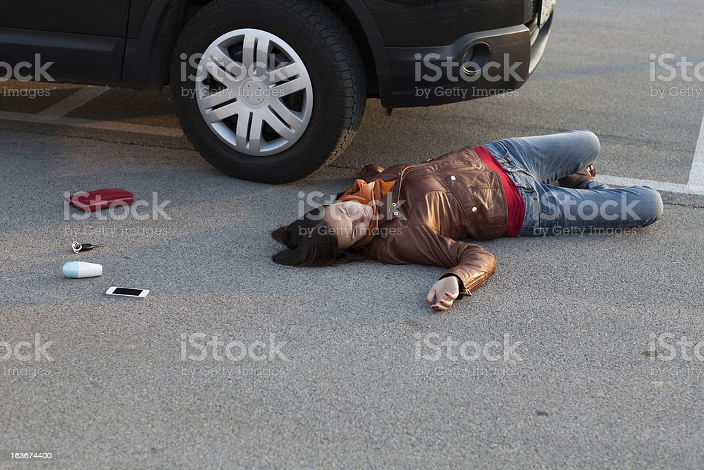 Traffic accident..young woman hit by a car stock photo