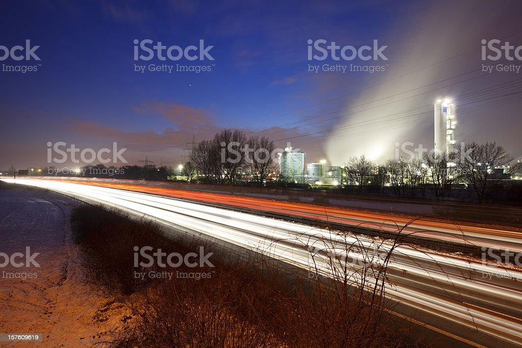 Traffic And Industry At Night royalty-free stock photo