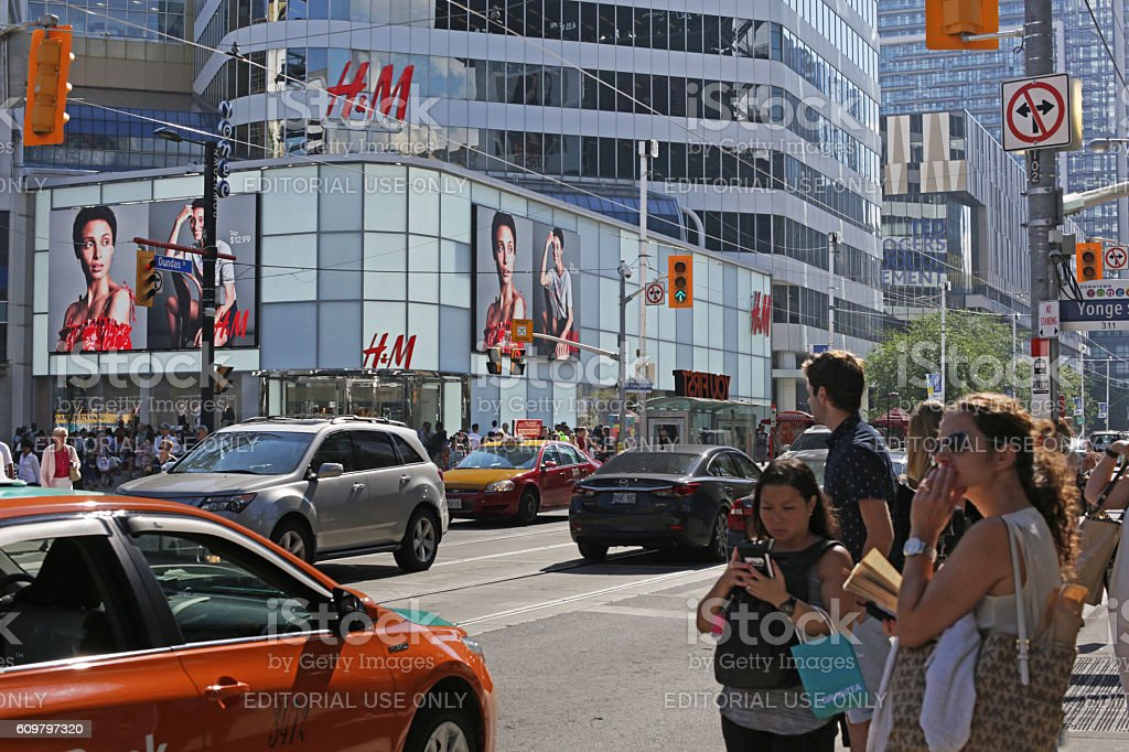 Traffic and Pedestrians Outside Yonge-Dundas Square, Toronto, Canada in Summer stock photo