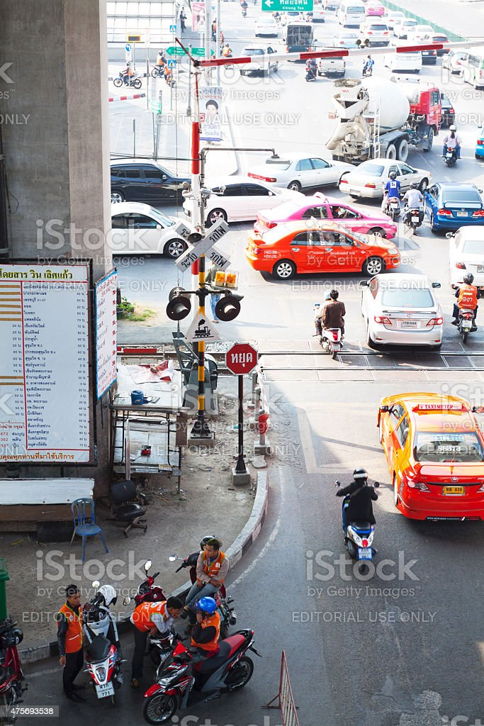 Traffic and railway crossing at Makkasan in Bangkok stock photo