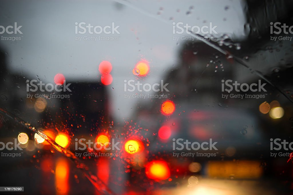 Traffic and rain in the city royalty-free stock photo