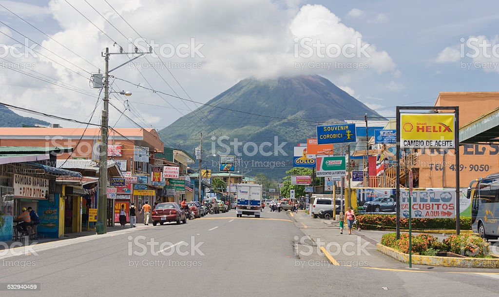 Traffic and Volcano Arenal in Costa Rica stock photo