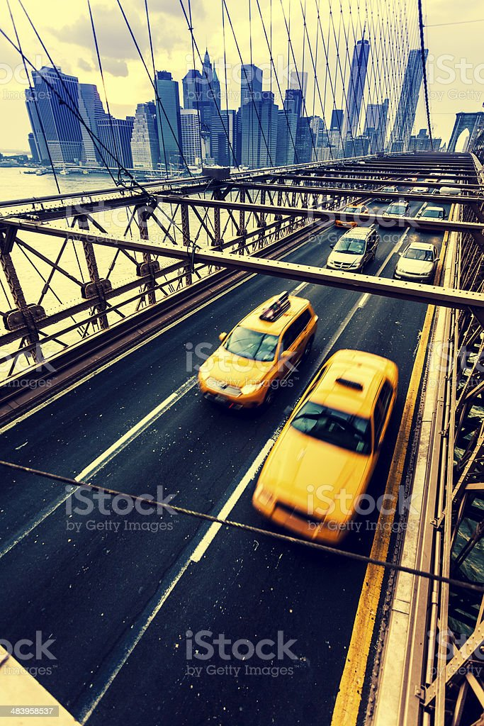 Traffic and Yellow Taxi on Brooklyn Bridge, New York City royalty-free stock photo