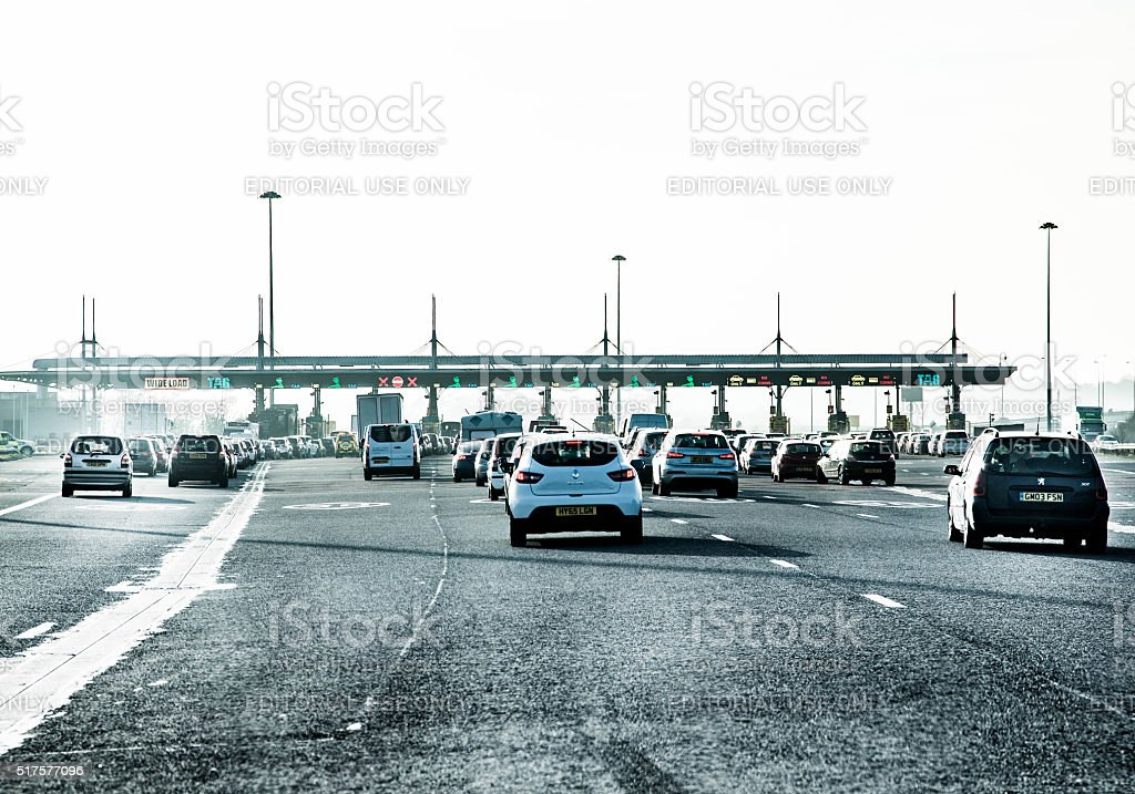 Traffic approaching toll booths stock photo