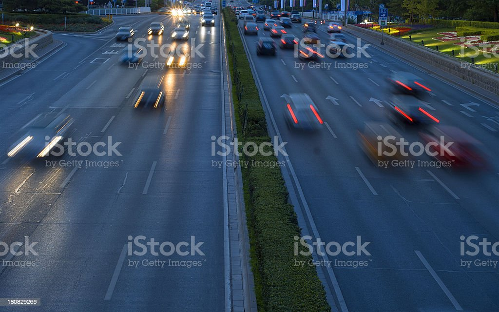 traffic at nightfall in modern city royalty-free stock photo