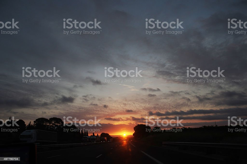 Traffic at sunrise stock photo