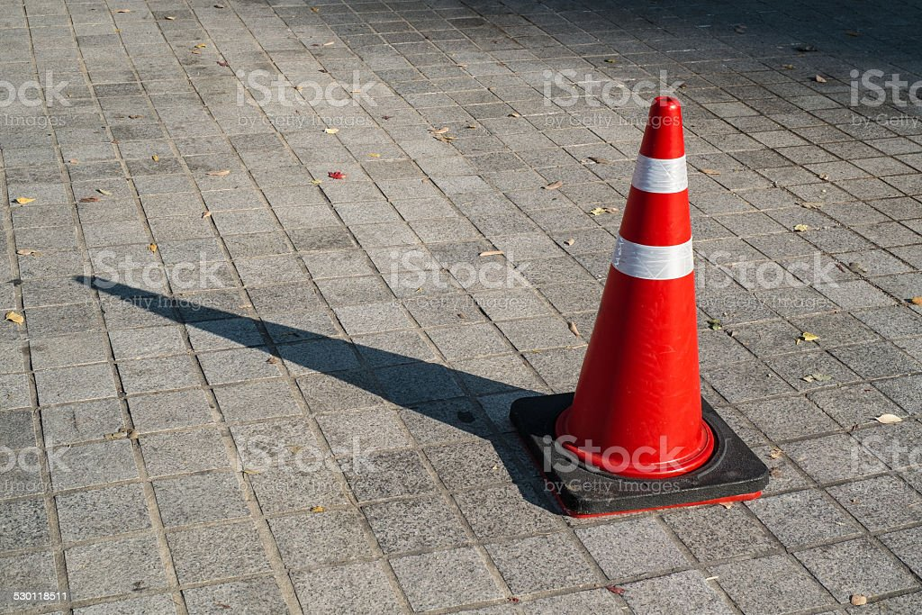 Traffic cone on the sidewalk stock photo