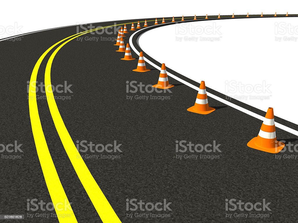traffic cone on winding road stock photo
