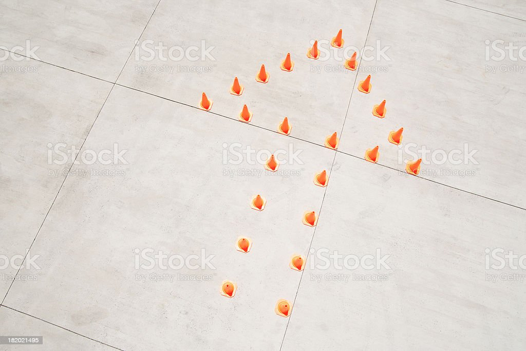 Traffic cones in arrow formation stock photo