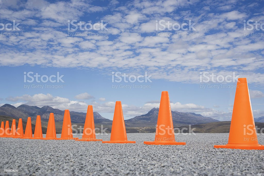 Traffic cones in line outdoors ground level view royalty-free stock photo