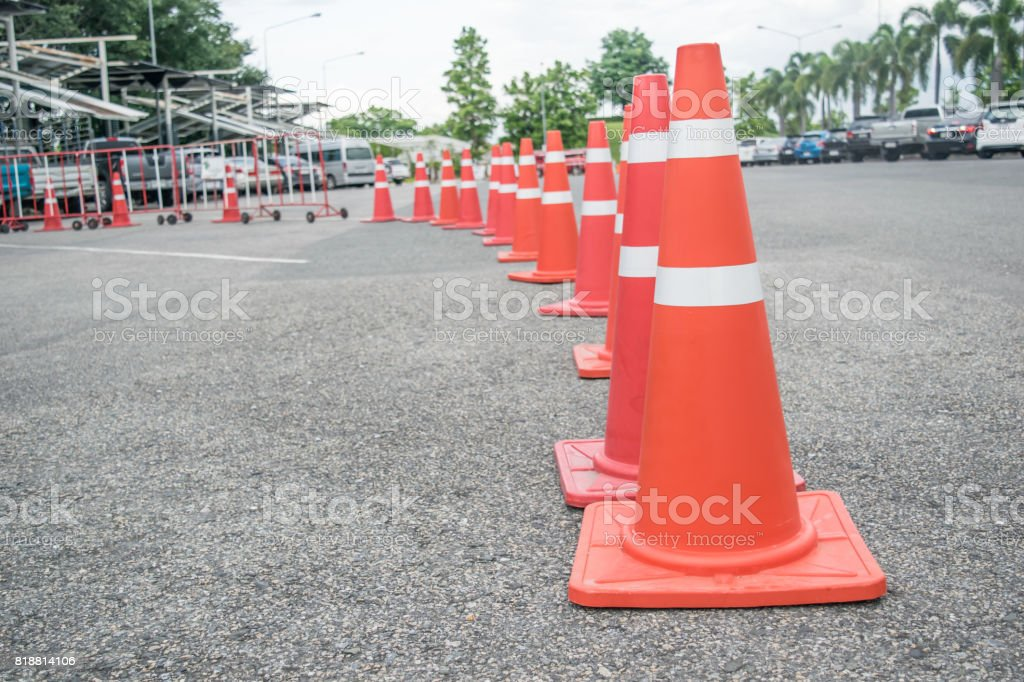 Traffic cones lined up in a row on the road stock photo