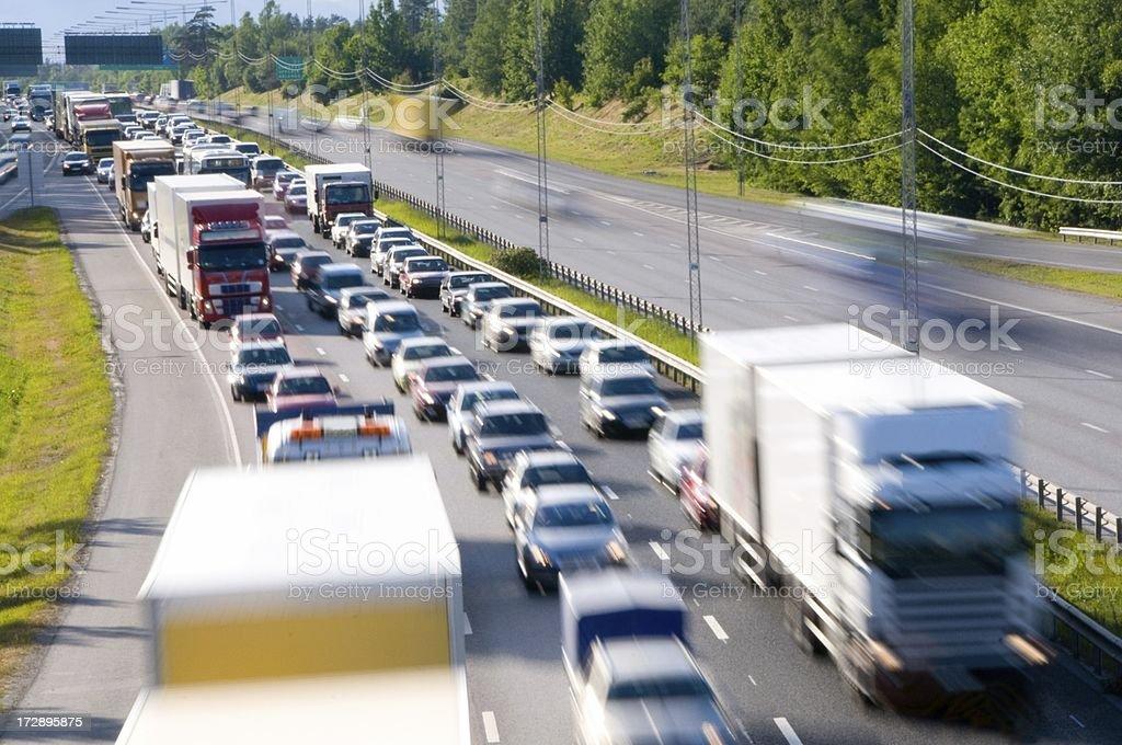 Traffic congestion, three motion blurred lanes stock photo