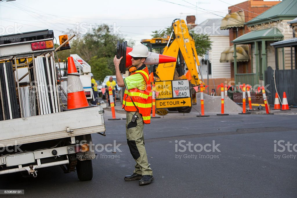 Traffic controler packing  traffic cones stock photo
