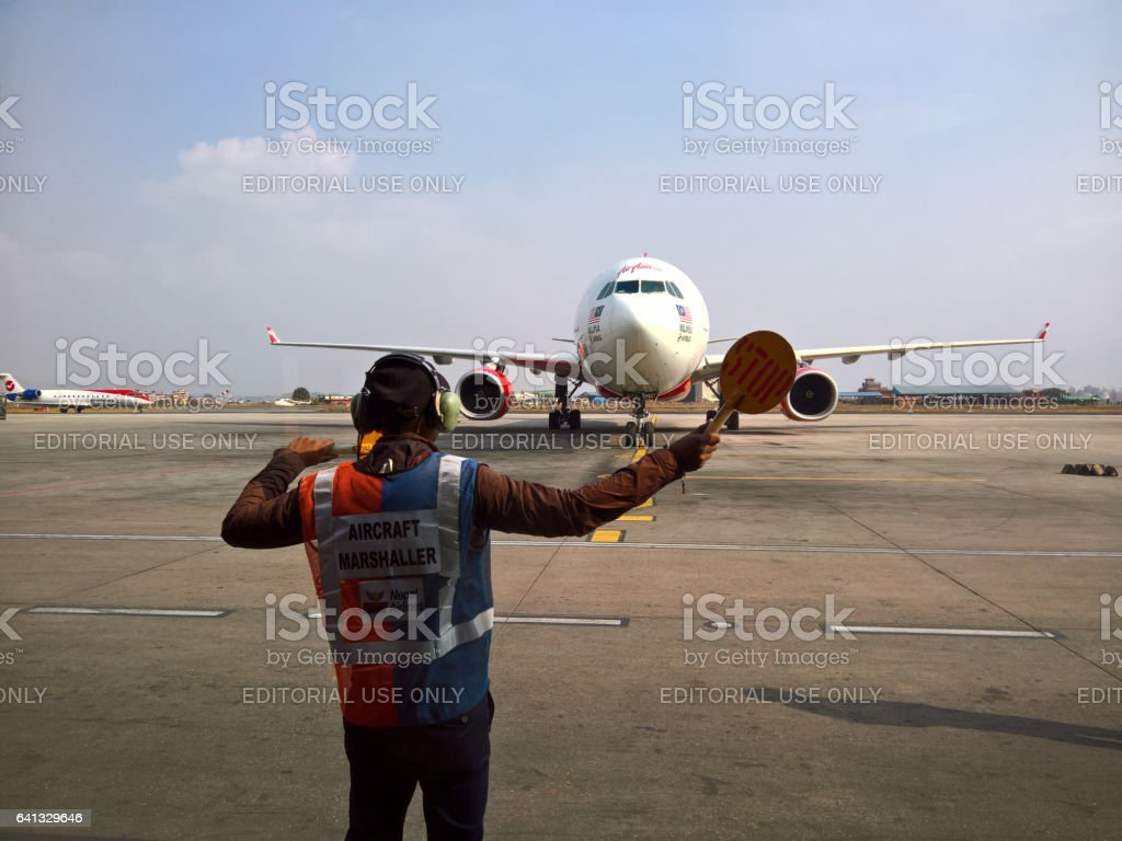 Traffic Controller with Malaysian Airlines stock photo