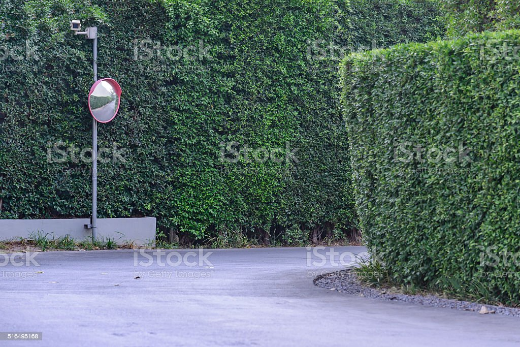 Traffic convex mirror with security camera at street corner. stock photo