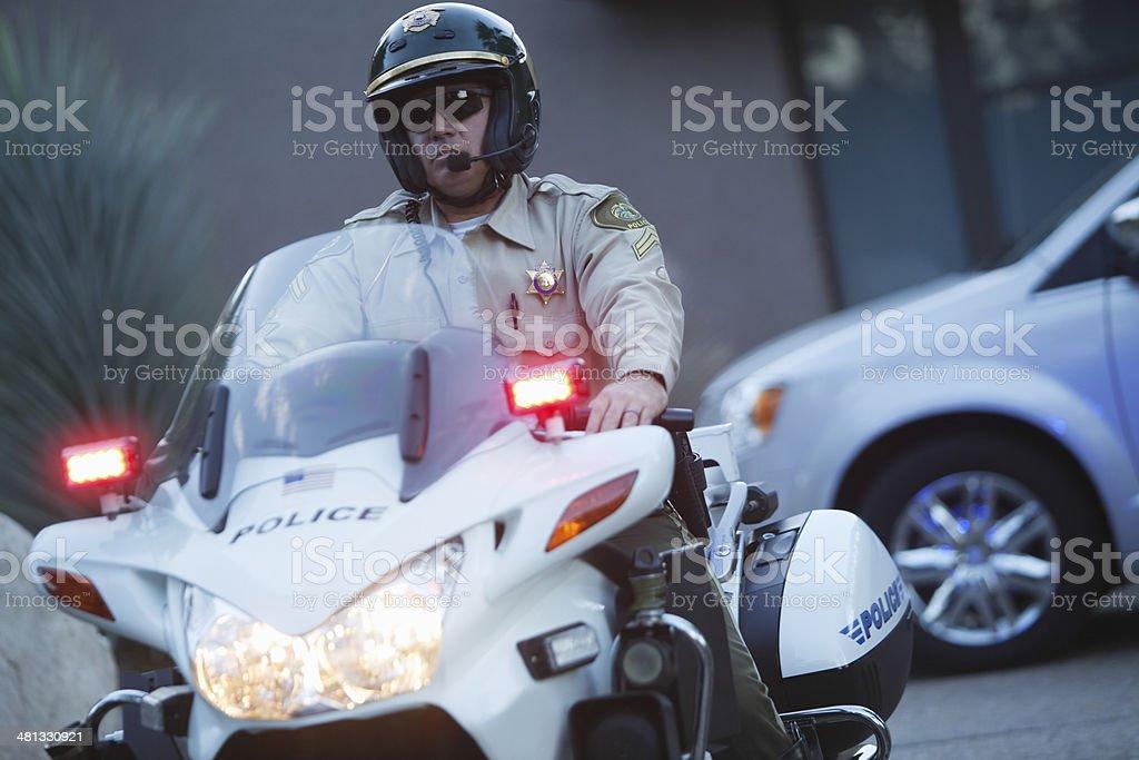 Traffic Cop Wearing Helmet While Riding Motorbike stock photo