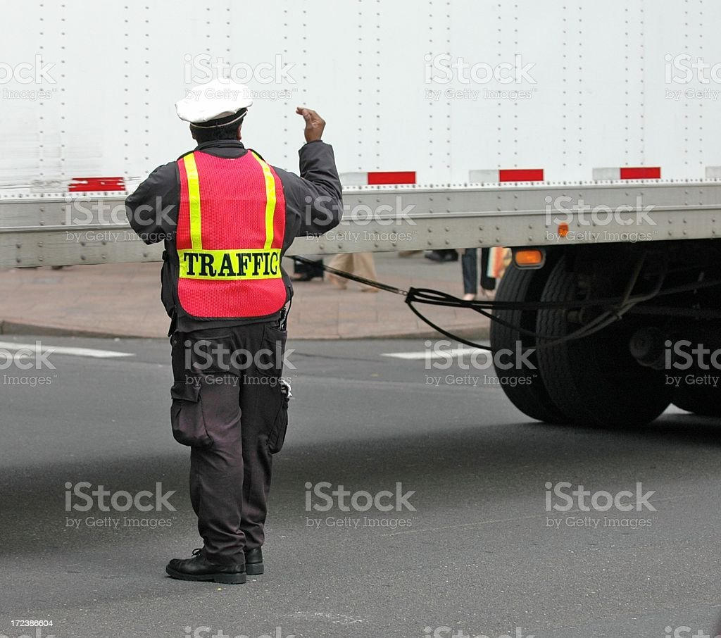 Traffic Cop with a Big Customer royalty-free stock photo