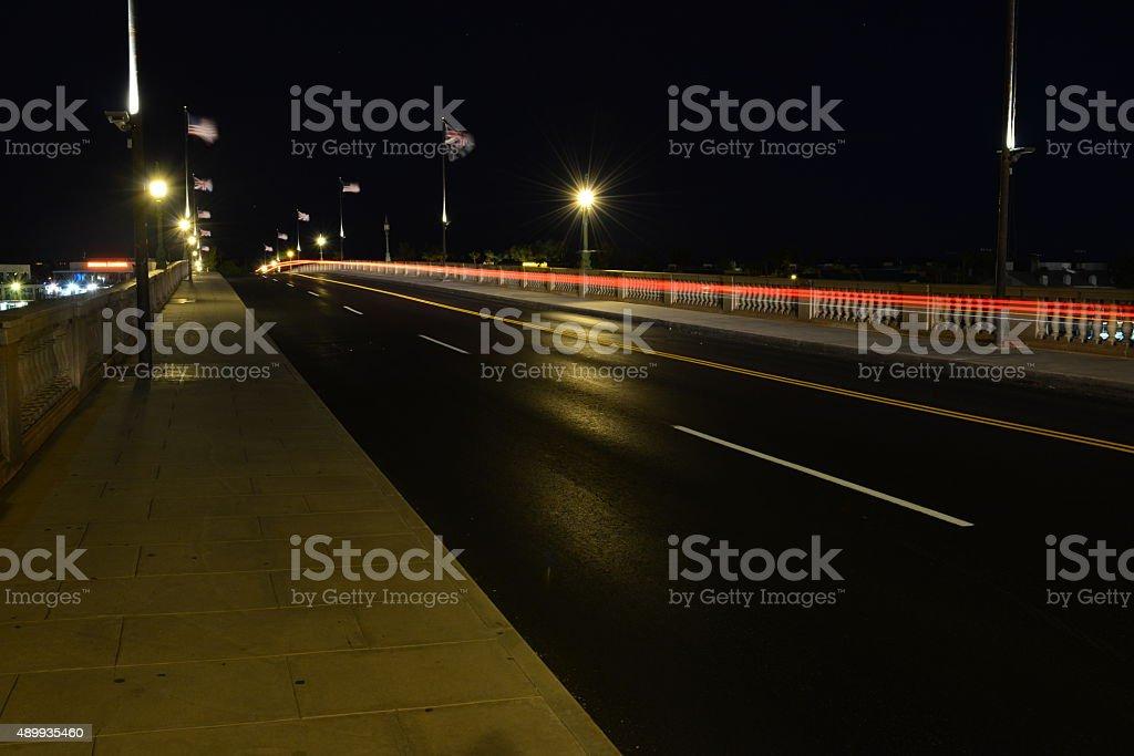 Traffic crossing lake Havasu at night. stock photo