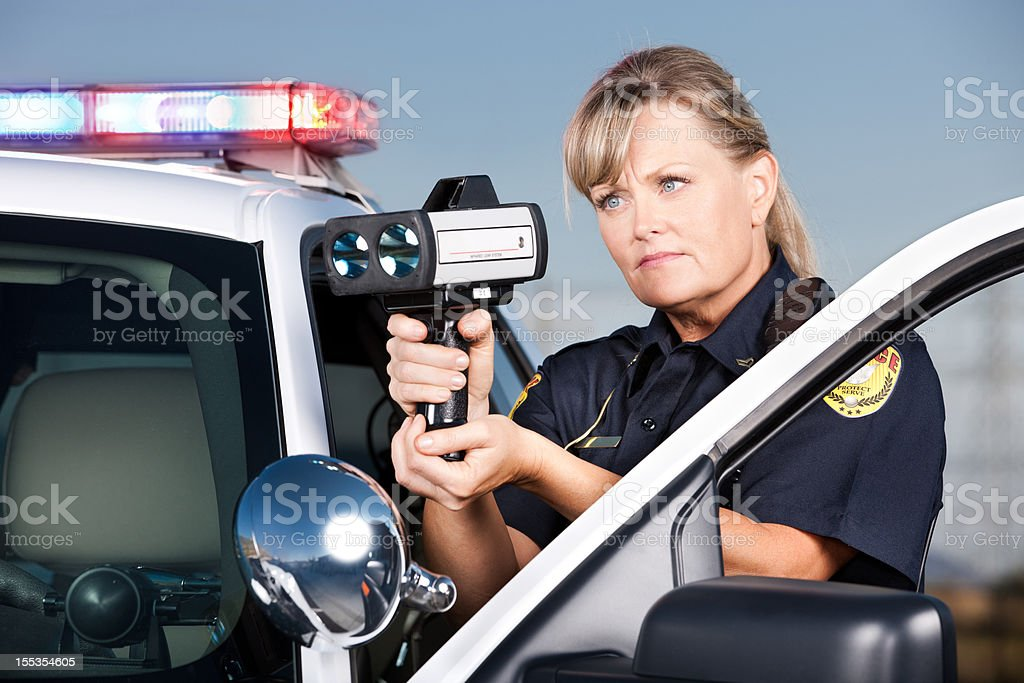Traffic Enforcement: Woman Police Officer with Laser Gun stock photo