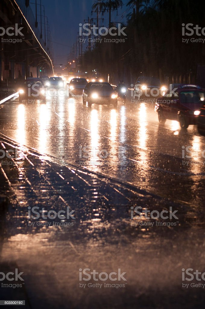 Traffic Headlights In The Rain In Bangkok, Thailand stock photo
