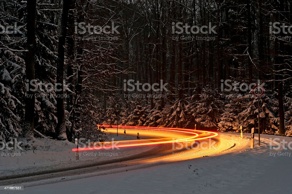 Traffic in a snowy curve royalty-free stock photo