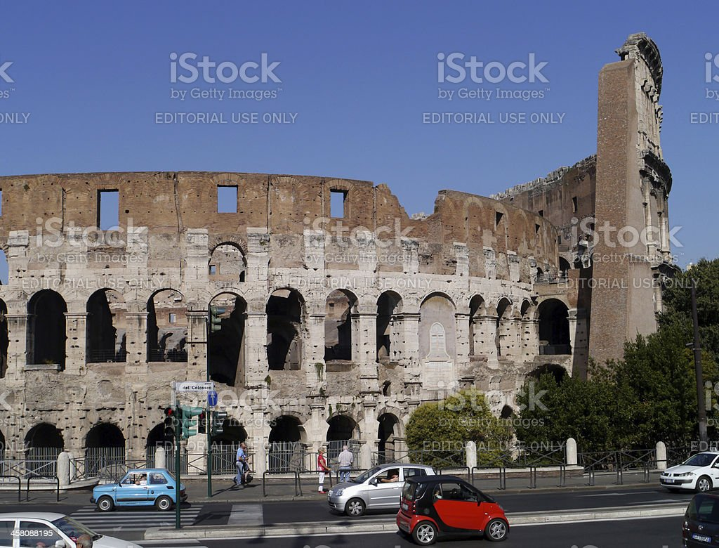 Traffic in front of Coliseum royalty-free stock photo