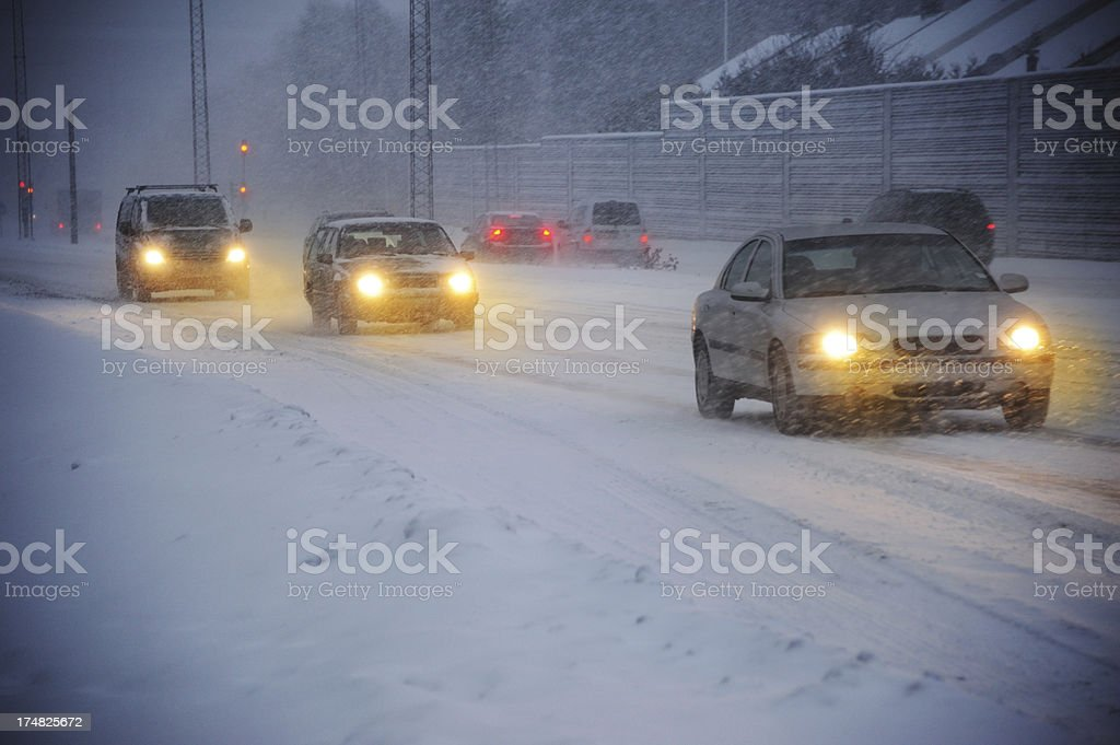 Traffic in snow storm, evening royalty-free stock photo