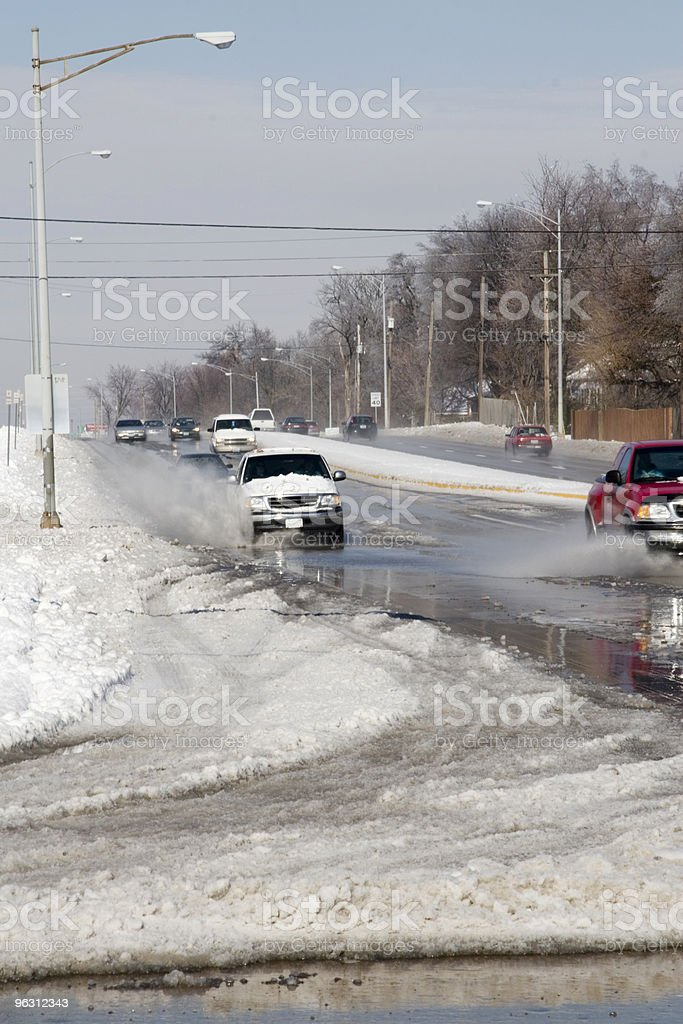 Traffic in the Melting Snow stock photo